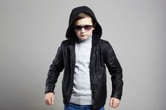 Fashionable little boy in hoodie and sunglasses royalty free stock photos