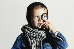 Fashionable little boy in scarf and jeans Royalty Free Stock Photos