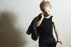 Fashionable little boy in scarf.stylish fashion children Stock Images