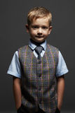 Fashionable little boy.smiling funny child in suit and tie Royalty Free Stock Photo