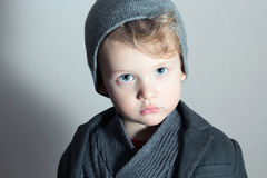 Fashionable Little Boy.Stylish Handsome Kid. Fashion Children. in suit, sweater and cap Royalty Free Stock Photography