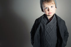 Fashionable Little Boy.Stylish Handsome Kid. Fashion Children. in suit, sweater and cap Royalty Free Stock Images