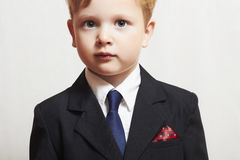 Fashionable little boy in suite.business kid.children.manager stock photography