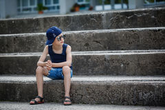 Fashionable little boy in sunglasses and cap. Childhood.  Summer Royalty Free Stock Photos