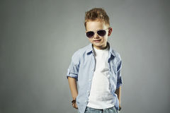 Fashionable little boy in sunglasses.stylish kid in jeans. Fashion children stock image