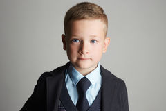 Little boy in a three-piece suit royalty free stock photo