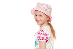 Fashionable little cute girl in shirt and hat, isolated on white background Royalty Free Stock Photography