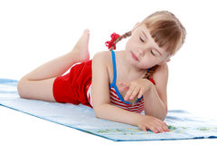 Fashionable little girl on the beach Royalty Free Stock Photo