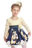 Fashionable little girl in a beautiful dress Stock Photo