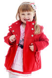 Fashionable little girl bright red coat in a Stock Photography