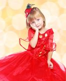 Fashionable little girl in a bright red dress . Stock Photography