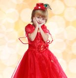 Fashionable little girl in a bright red dress . Stock Image