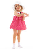 Fashionable little girl in a pink dress. Royalty Free Stock Photography