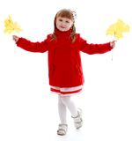 Fashionable little girl in a red coat Stock Photos