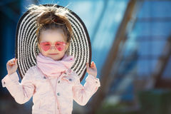 Fashionable little girl wearing a hat and sunglasses. summer vacation concept Stock Images