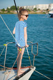 Fashionable little kid aboard luxury boat in summer sea cruise Stock Images