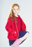 Fashionable Little Red-Haired Caucasian Girl In Studio Stock Photo
