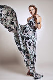 Fashionable long flying dress Royalty Free Stock Photography