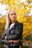 Fashionable look of young blonde woman in black leather jacket stock photography