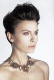 Fashionable luxurious young woman closeup stock photo