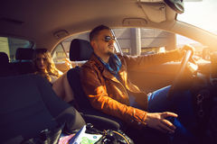 Fashionable male driven in the backseat a stunning girl Royalty Free Stock Images
