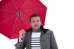 Fashionable Male under an umbrella. A young fashionable multi-racial male under an umbrella. Ready for raining weather Royalty Free Stock Images