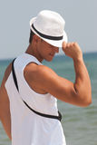 Fashionable male with white fedora hat at the beach Stock Photo