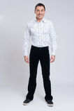Fashionable man full length. Over gray background royalty free stock images