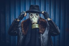 Portrait of man with gas mask. Fashionable man with gas mask on the head,selective focus Stock Photography