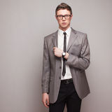 Fashionable man in grey suit Royalty Free Stock Images