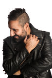 Fashionable man in leather jacket. Trendy man standing against a white background wearing a black jacket and jeans, feeling relaxed and comfortable Stock Photography