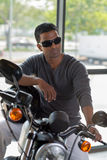 Fashionable man on motorcycle Royalty Free Stock Images