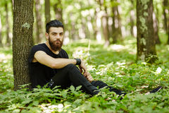 Fashionable man in the oak forest Stock Photo