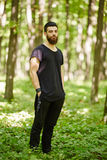 Fashionable man in the oak forest Stock Photography