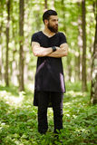 Fashionable man in the oak forest Royalty Free Stock Photography