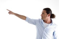 Fashionable man pointing sideways Stock Photos