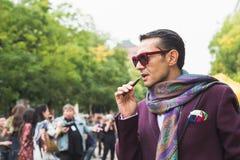Fashionable man posing during Milan Fashion Week Stock Photos