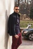 Fashionable man posing during Milan Men`s Fashion Week Royalty Free Stock Image