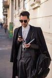Fashionable man posing at Milan Men`s Fashion Week Royalty Free Stock Image