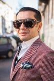 Fashionable man posing at Milan Men`s Fashion Week Royalty Free Stock Images