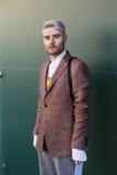 Fashionable man posing at Milan Men`s Fashion Week Stock Images