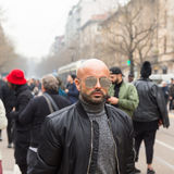 Fashionable man posing during Milan Women`s Fashion Week Stock Photos
