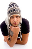 Fashionable man posing in woolen hat Stock Images