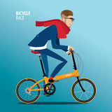 Fashionable man rides on a folding bike Royalty Free Stock Images