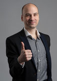 Fashionable man showing his thumb up Stock Photography