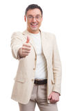 Fashionable man showing his thumb up Royalty Free Stock Photos