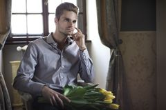 Fashionable man sitting Stock Images
