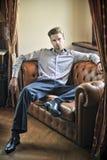Fashionable man sitting Stock Images