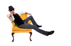 Fashionable man sitting on a chair Stock Images