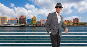 Fashionable man standing by a bridge in Curacao Stock Photography
